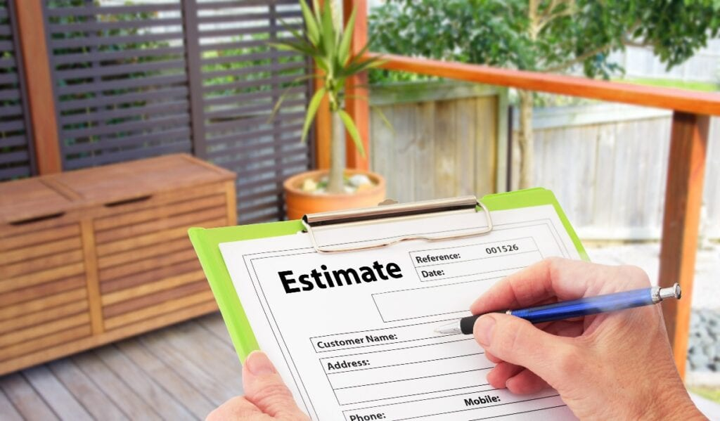 Hand writing an estimate on a clipboard for Home Building Renovation